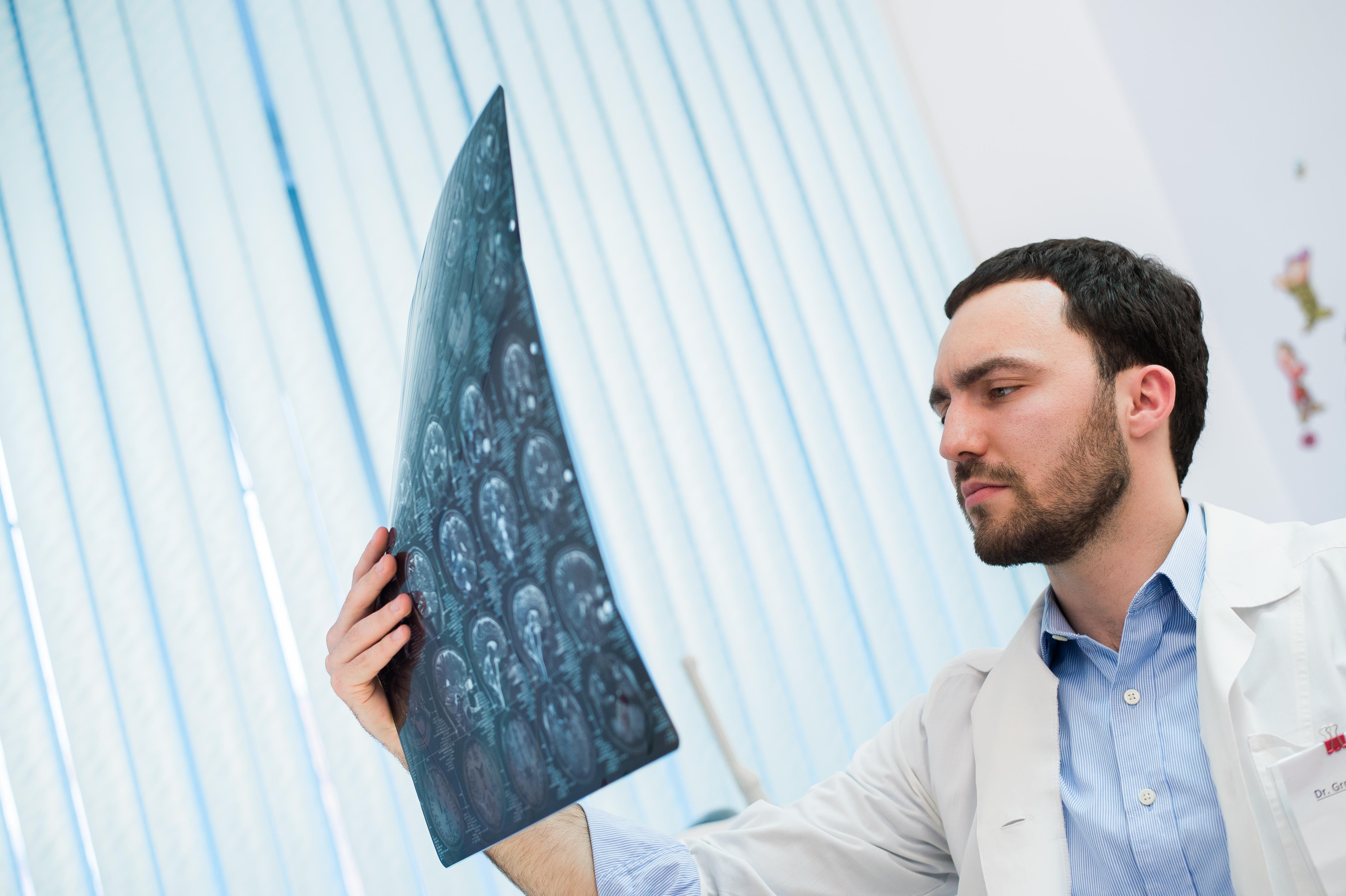 Man looking at MRI images