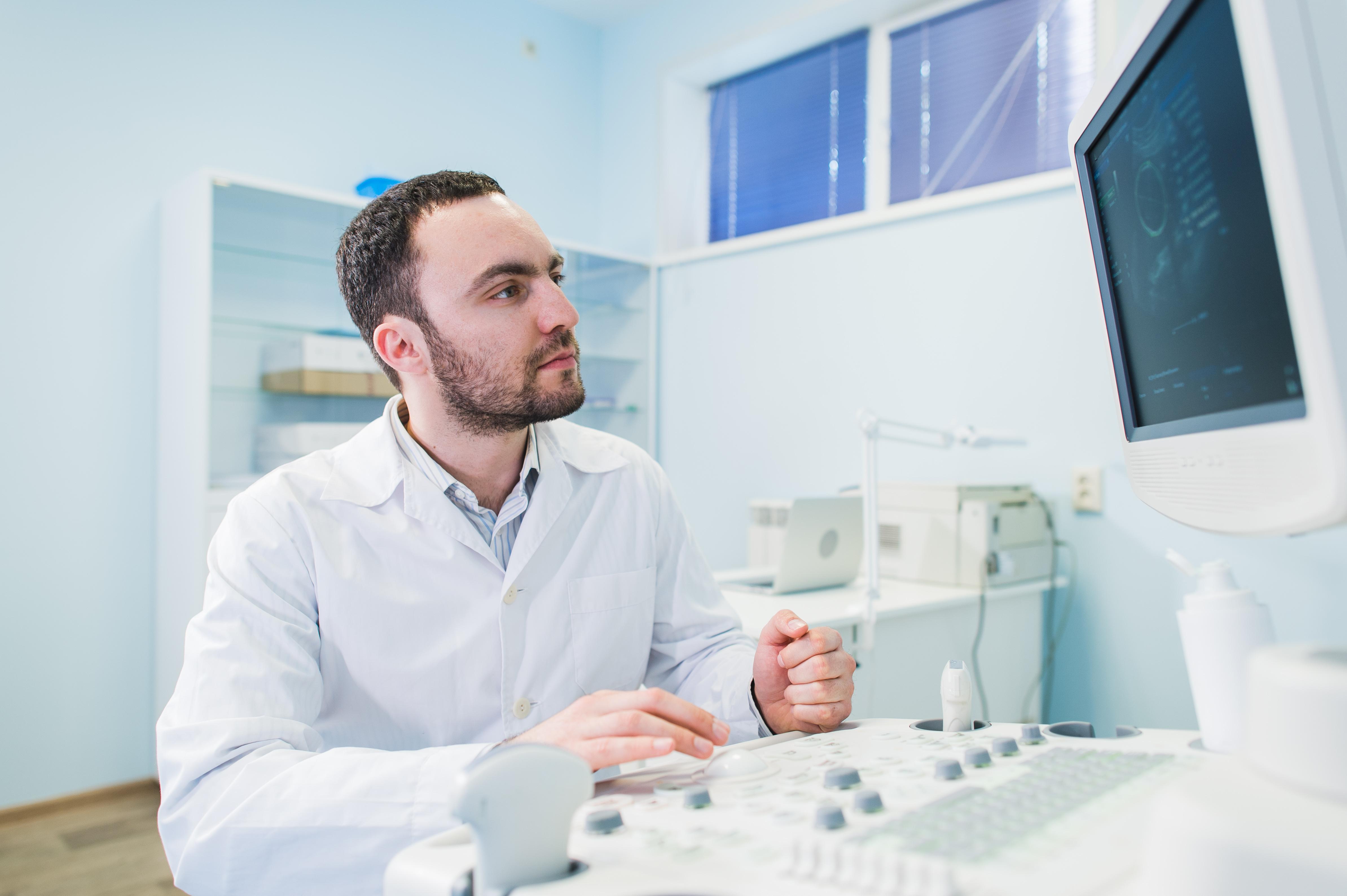 doctor using ultrasound machine