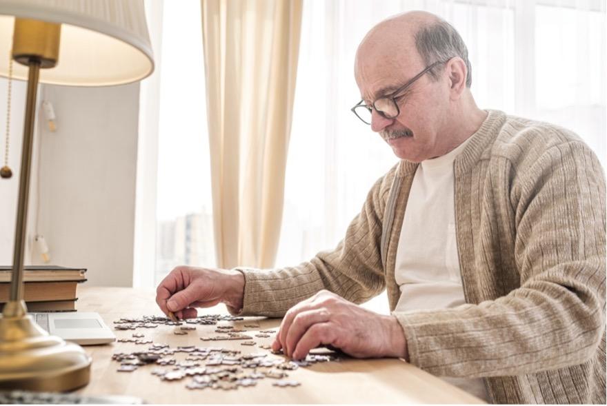 Senior man doing a puzzle